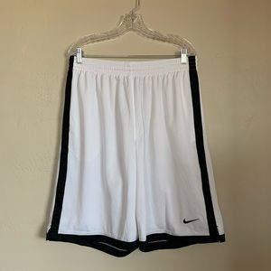 NIKE men's black & white basketball shorts.